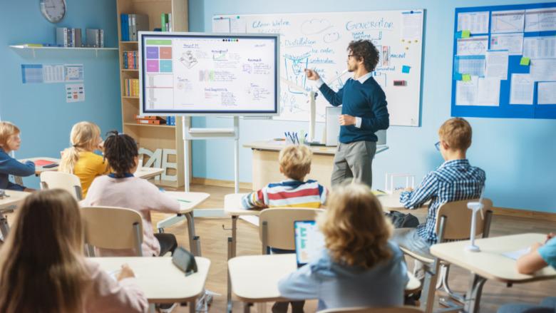 teacher standing in a classroom