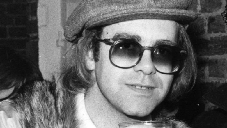 Elton John at party