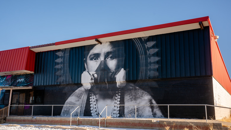 Mural of a Navajo wearing a gas mask