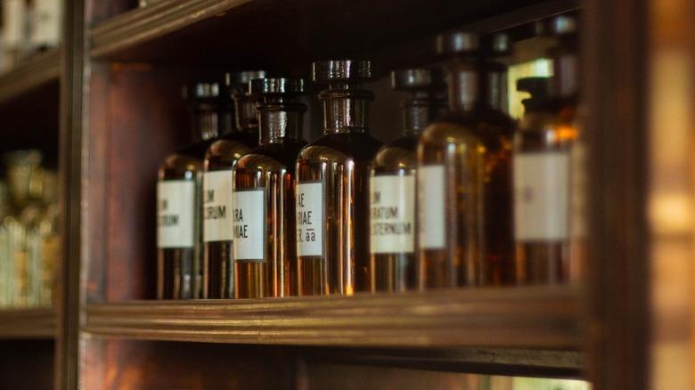 Brown bottles of medicine in a cabinet