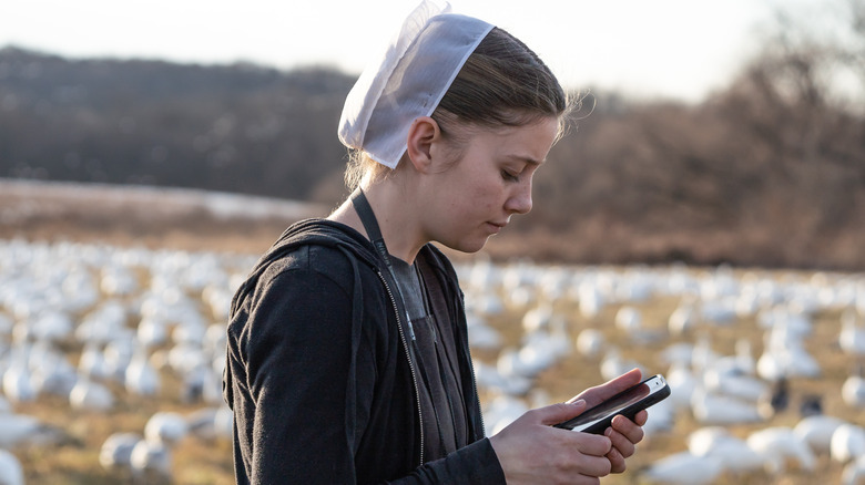 an amish woman using a cell phone