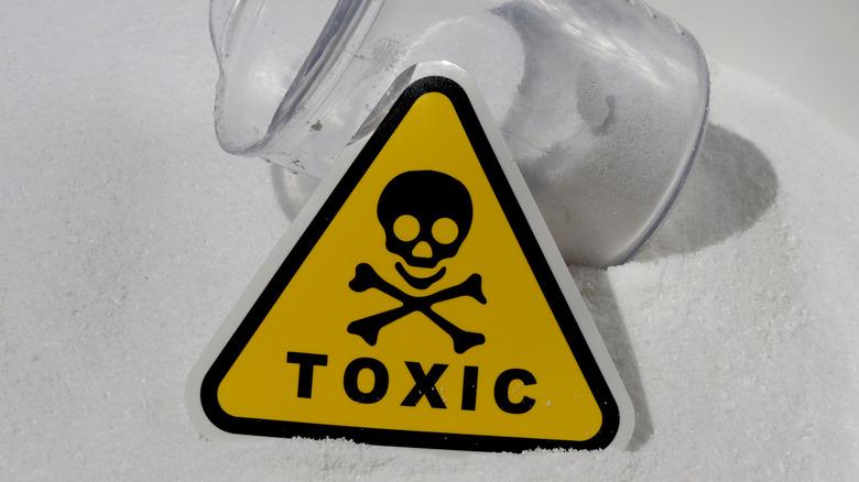White powder with toxic warning label