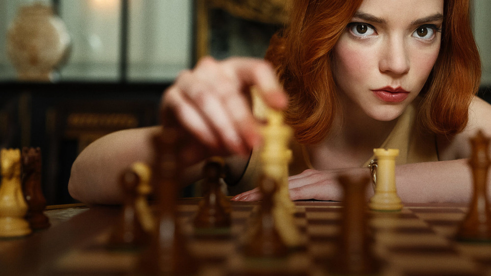 """Anya Taylor with chess piece in """"The Queen's Gambit"""""""