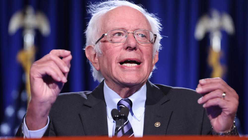 Bernie Sanders speaking at podium