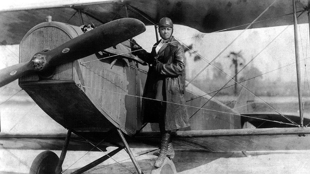 Bessie Coleman with her plane