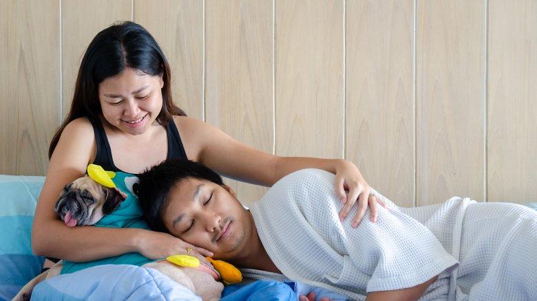 Asian couple cuddling