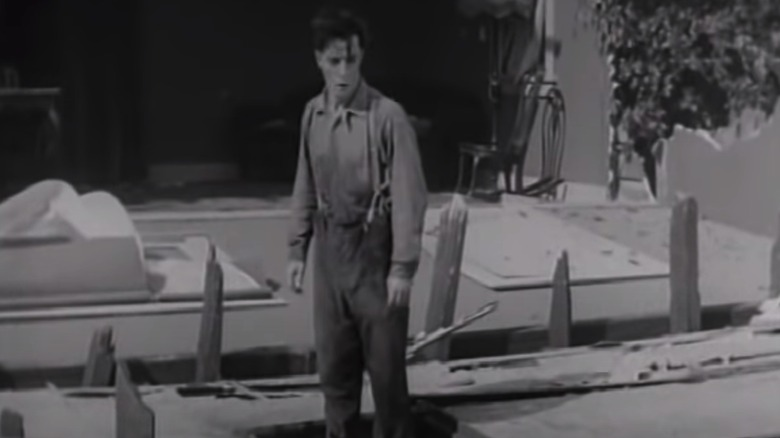 A house falls around Buster Keaton