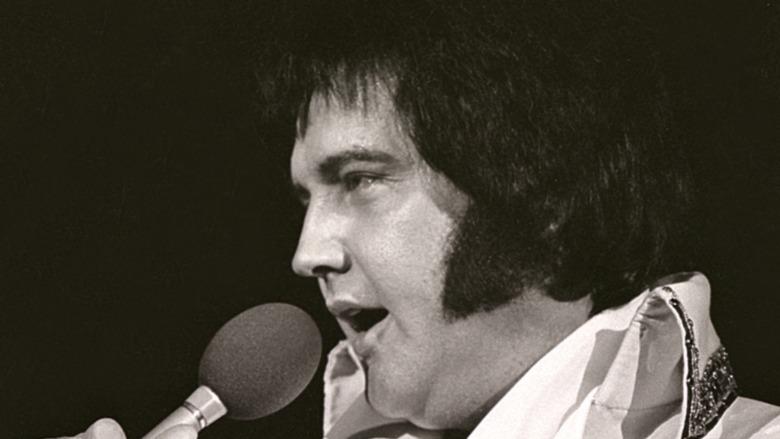 Elvis performing on stage