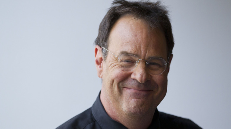 A smiling closeup shot of Dan Ackroyd