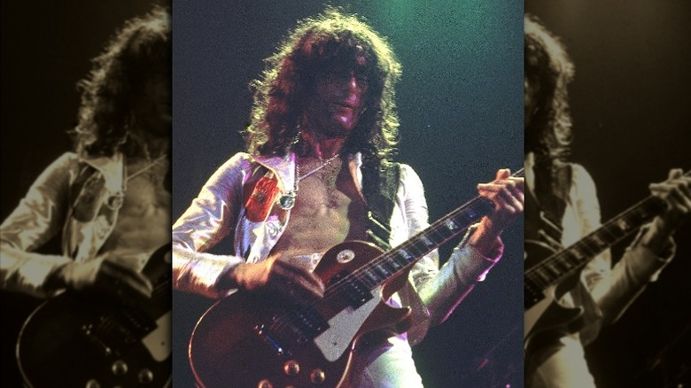 Jimmy Page playing guitar in 1975