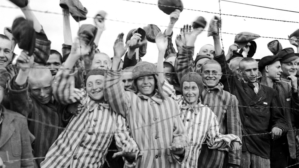 oung prisoners interned at Dachau concentration camp cheering their liberators, the 42nd Division of the US Army. The boy second from left has been identified as 18 year old Juda Kukiela. (Photo by Abrahams/Getty Images)