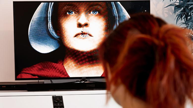 woman watching the handmaid's tale