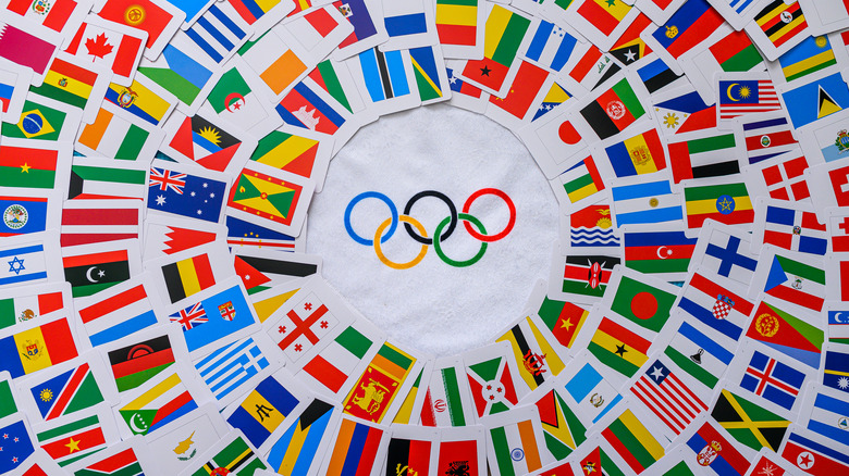 Olympic rings surrounded by world flags