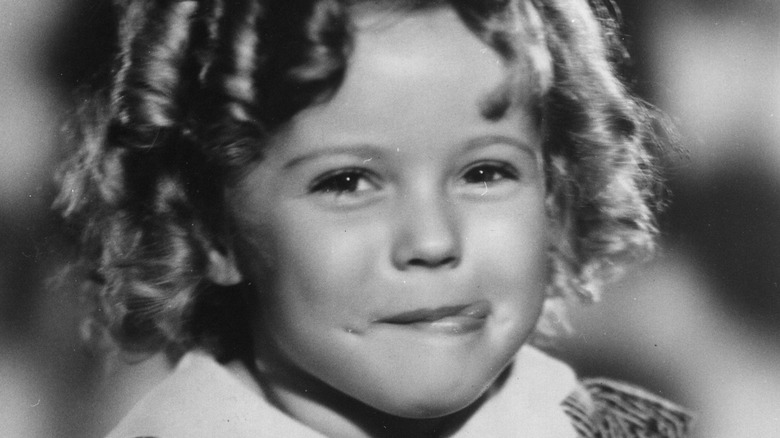 Shirley Temple sticking her tongue out