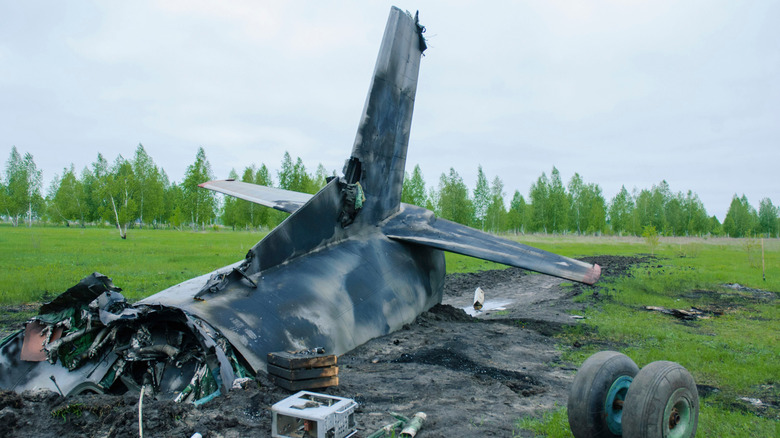 Plane crash wreckage in field