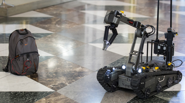 robot with a suspicious backpack during a sarin drill