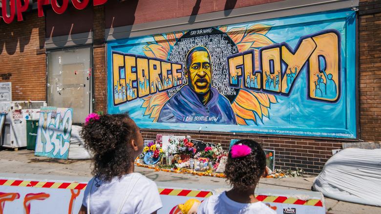 Children view George Floyd mural