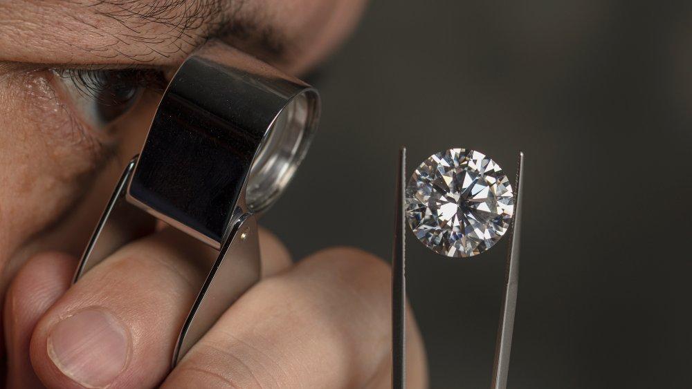 A jeweler takes an up-close look at a diamond