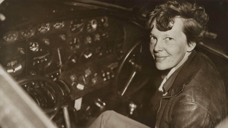 Amelia Earhart siting in cockpit