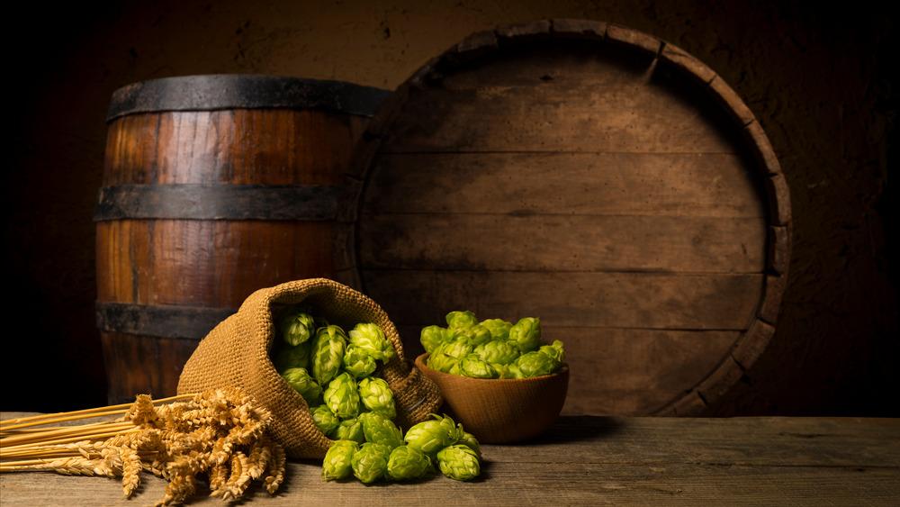 Barrels, hops and barley for some vintage beer making