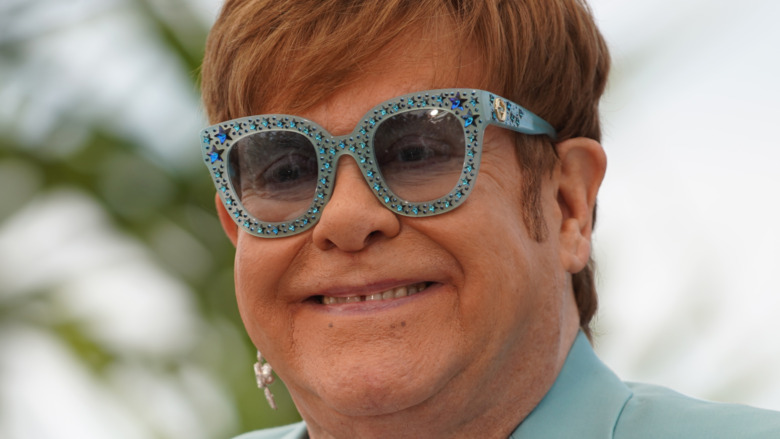 Elton John wearing sequined glasses
