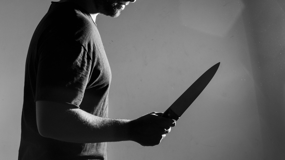 Man threateningly holding a kitchen knife