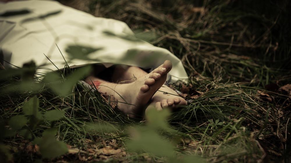 Murder victim lying in field
