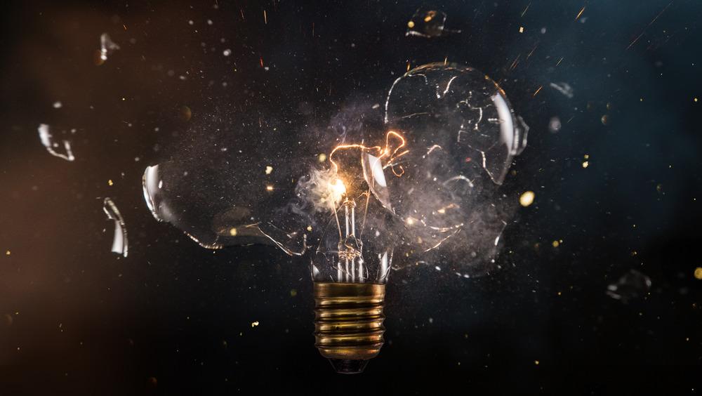 Lit lightbulb explodes