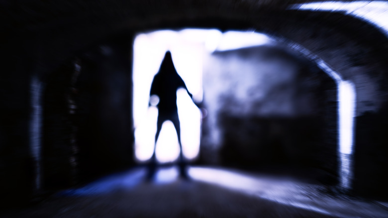 Scary man entering dungeon