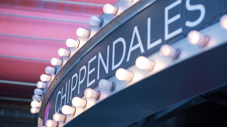 Chippendales sign surrounded by lights