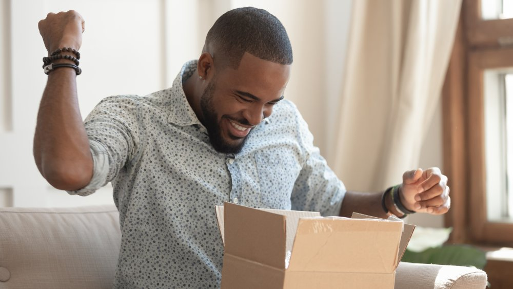 A man who is very, very excited about receiving a package