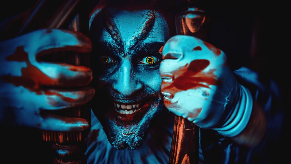 Evil clown behind railing