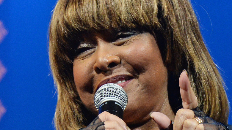Tina Turner with microphone