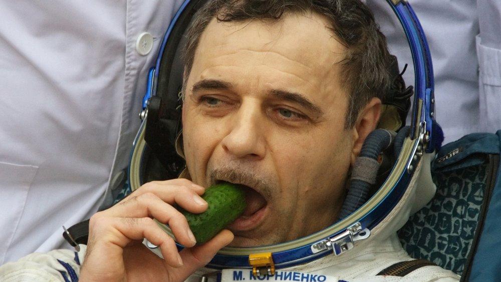 Cosmonaut eating a cucumber