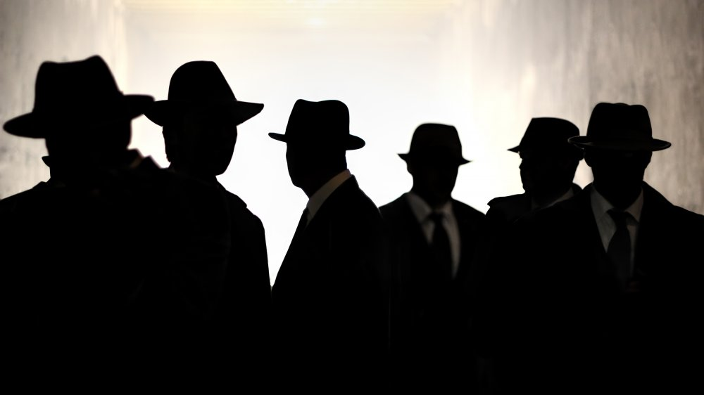 Silhouettes of men in hats