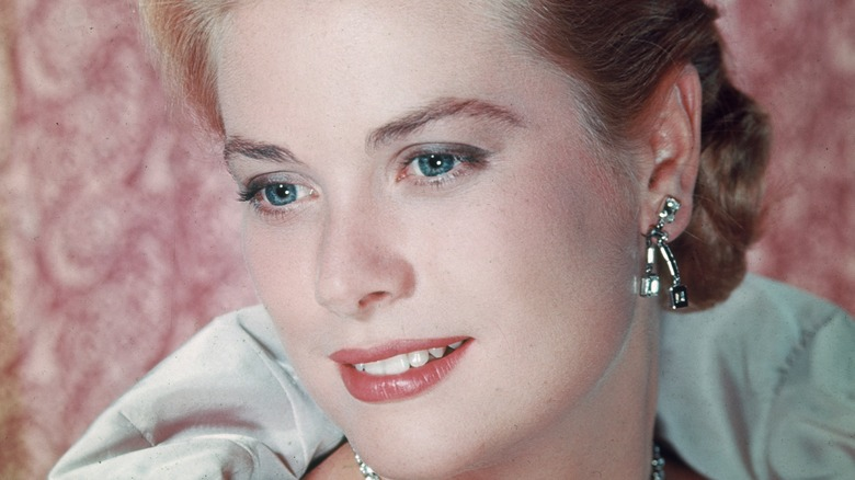 Grace Kelly posing for photo, smiling