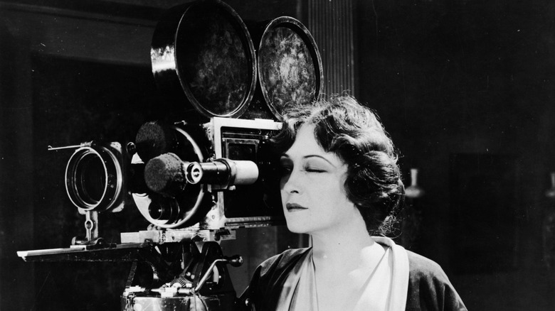 Pauline Frederick looking through a camera