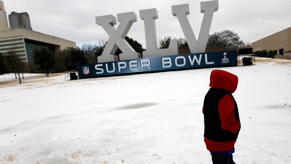 child and Super Bowl sign