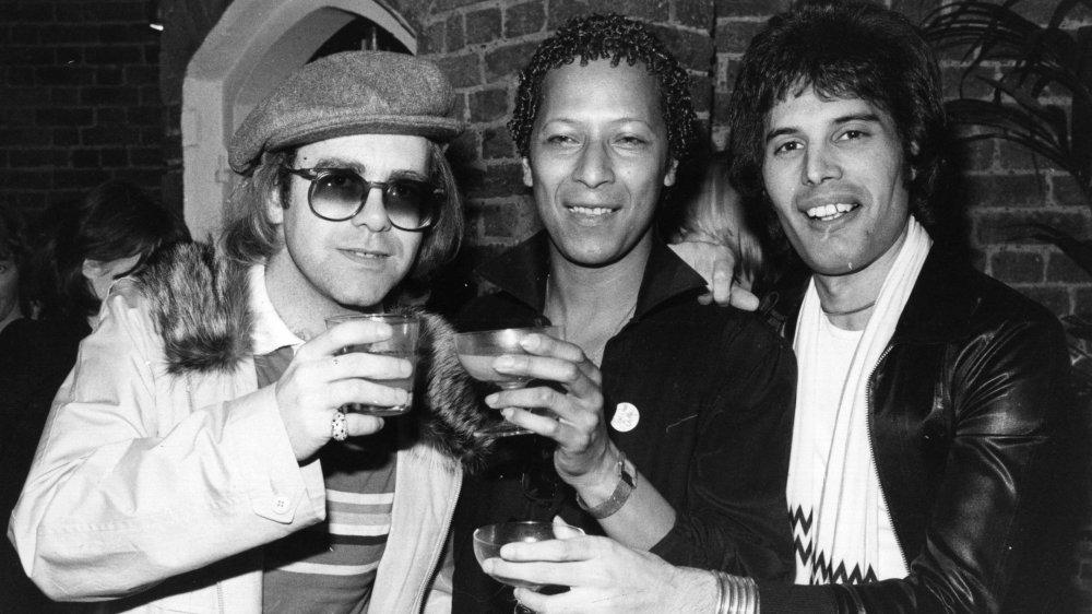 Singer songwriter Elton John with Peter Straker and Freddie Mercury
