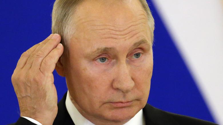 Valdimir Putin cupping ear