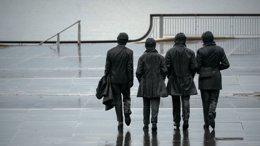 A statue of the Beatles looking over Merseyside