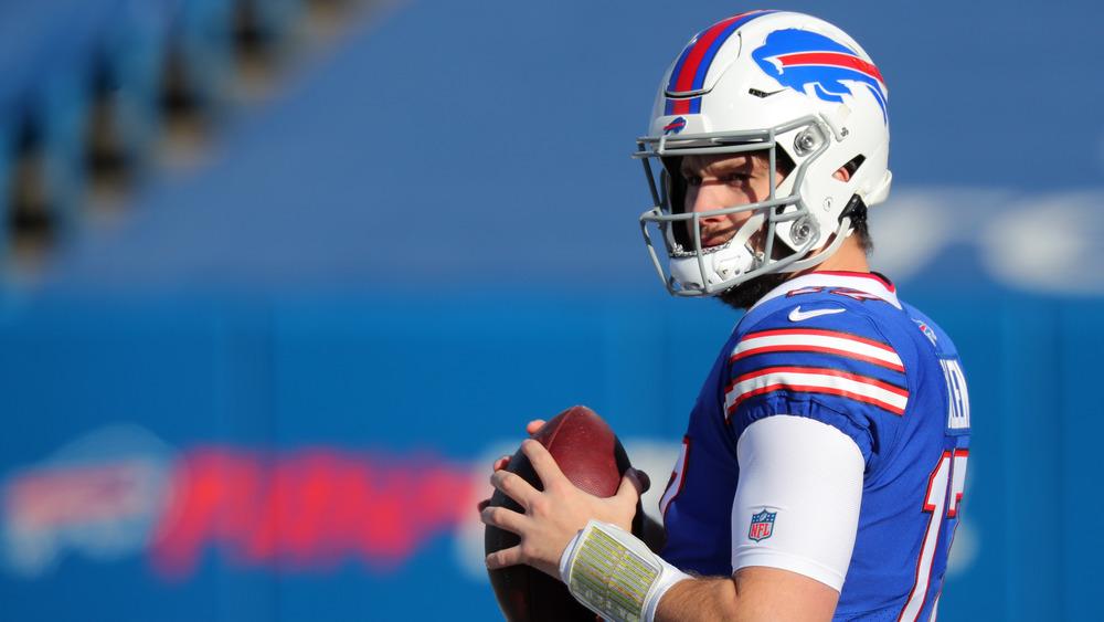 Bills' Josh Allen holding football