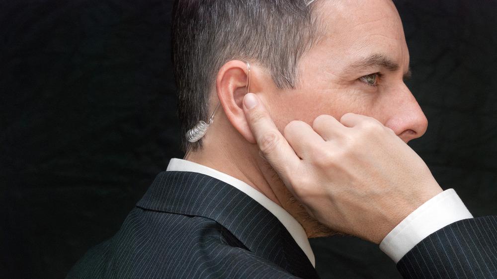 man's head with earpiece