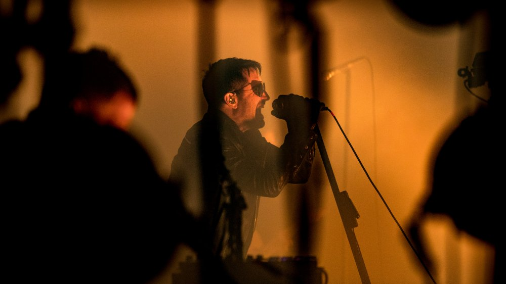 Trent Reznor putting on a Nine Inch Nails show