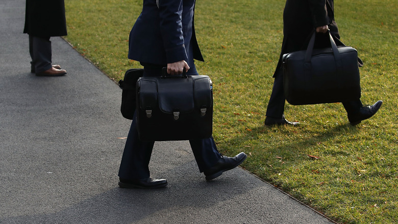 military officer carrying the nuclear football