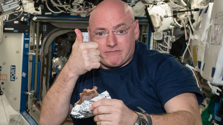 Astronaut Scott Kelly enjoying space food