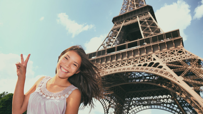 Asian tourist in front of the Eiffel Tower