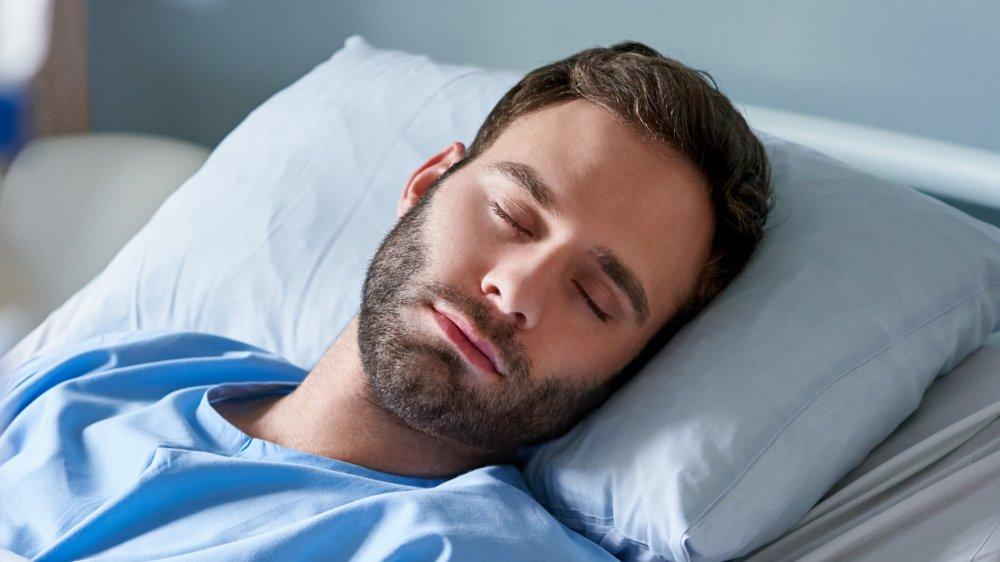 sleeping man in hospital bed