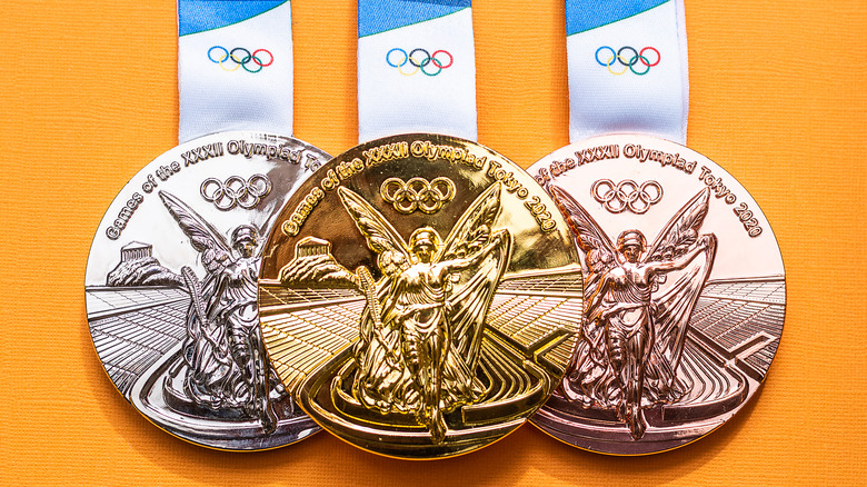 Tokyo Olympic medals against a yellow background