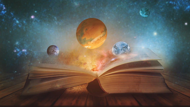 Bible with sky and planets